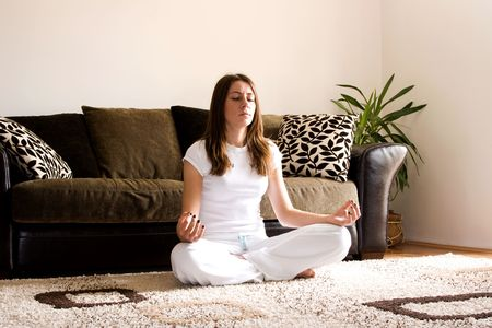 Young woman practise yoga in apartment on floor. Stock Photo - 3116726