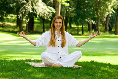Beautiful woman in white practice yoga outdoors. Stock Photo - 3138425