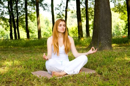 Young woman practice yoga outdoors in nature environment. Stock Photo - 3138435