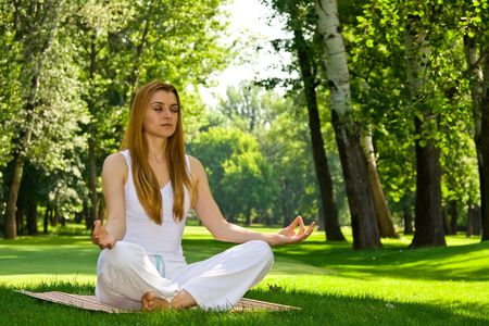 Beautiful woman in white doing yoga outdoors. Stock Photo - 3148052