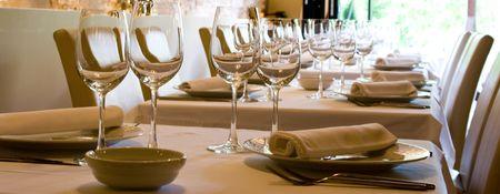 Glasses of wine set at restaurant table.