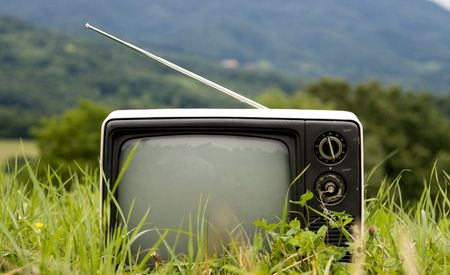 Old TV on ground.  Metaphor for all around television.