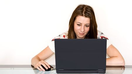 Young beautiful student using laptop. photo