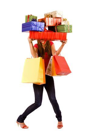 Attractive woman holding many gift boxes and bags.