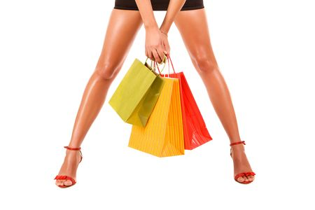 Attractive legs with colorful shopping bag. photo
