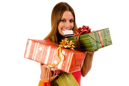 Beautiful shopping girl hold gift box in hand and credit card in mouth. Stock Photo - 3720671