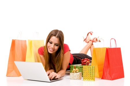 online shop: Beautiful young woman shopping over internet.