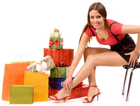 Attractive woman with many gift boxes and bags. photo