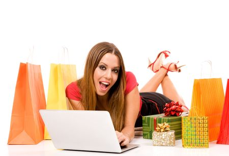 Beautiful young woman shopping over internet. photo