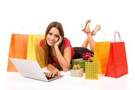 christmas shopper: Beautiful young woman shopping over internet.