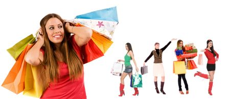Beautiful shopping girl with colorful bags and blurred girls in background. Stock Photo