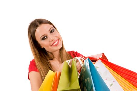Beautiful shopping girl with colorful bags. photo