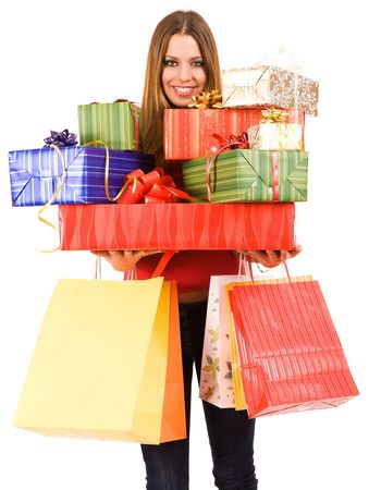 Beautiful woman holding many gift boxes and bags. Stock Photo