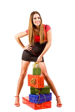 Attractive woman with many colorful gift boxes. photo