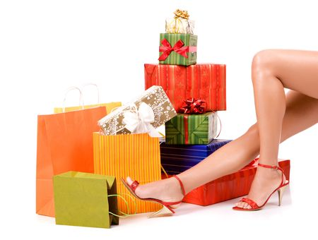 Attractive woman legs with many colorful gift boxes. photo