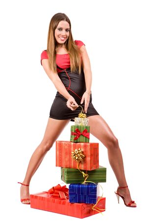 Attractive shopping girl with colorful gift boxes. photo