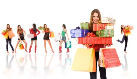 Shopping woman with bag and gift boxes and blurred girl in background.