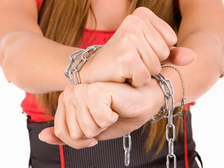 captured: Woman trafficking concept by hands chaind. Stock Photo