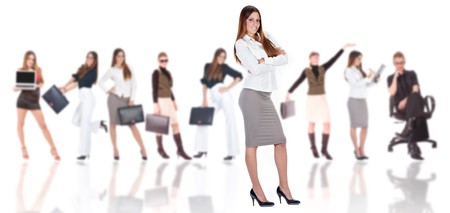 Successful businesswoman with business team in background (blurred). Stock Photo