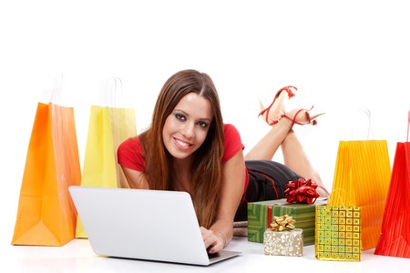 Beautiful shopping girl with bags and boxes. Stock Photo