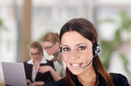 enviroment: Successful businesswoman with charming smile in office enviroment. Stock Photo