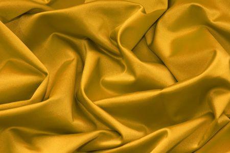 Luxurious gold satin background. Stock Photo - 4586432
