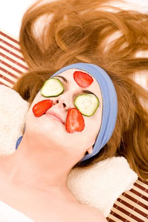 Beautiful spa woman with fruit mask over face. Stock Photo - 4724255