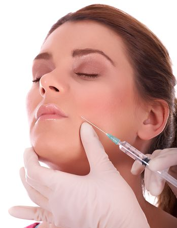 Beautiful woman getting botox injection against aging process. Stock Photo - 4724254