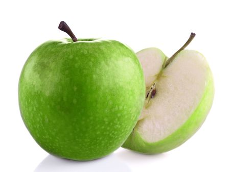 fruitage: Green apple and half against white background.