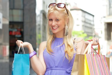 Beautiful shopping woman with bags in city environment. Stock Photo - 4891925
