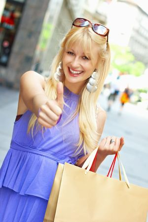 Beautiful shopping woman with bags in city environment. Stock Photo - 4891920