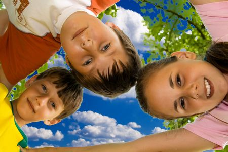 Happiness kids fun outdoors with blue sky in background. photo