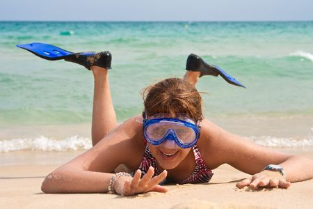 Woman with diving mask and flipper fun on the beach. photo