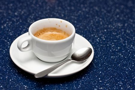 expresso: Cup of expresso coffee with spoon on blue background. Stock Photo