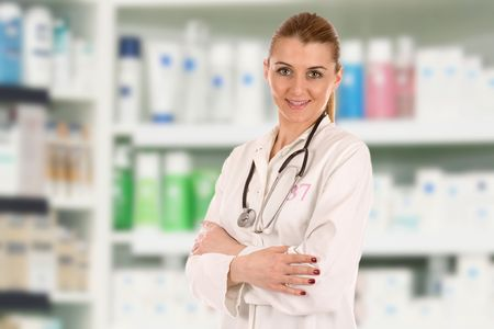 Portrait of friendly young doctor over drug store. Stock Photo - 5626781
