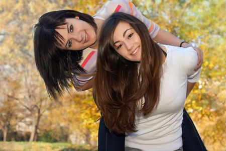 Teenager girls best friends have fun in the park. Stock Photo - 5983262