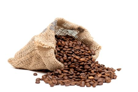Bag of roasted coffe beans over white background.