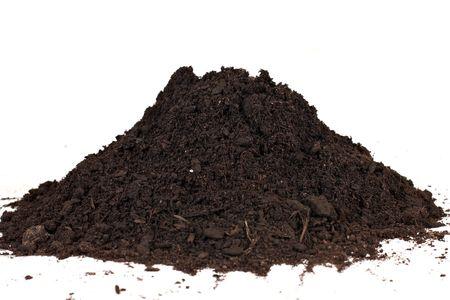 Heap of soil over white background.