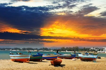 Tropical beach with boat at sunset. Stock Photo - 7913108