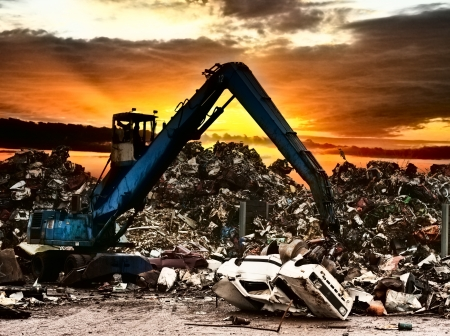 scrap heap: Car recycling to the dump.Dramatically scene at the sunset.