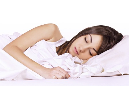 pillow sleep: Portrait of beautiful young woman sleeping on the bed. Stock Photo
