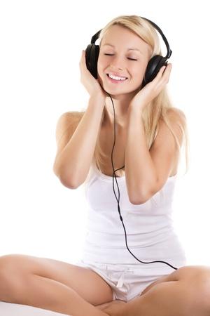 Portrait of beautiful woman listening music. photo