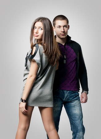 Portrait of romantic young couple over gray background. Stock Photo - 8441937