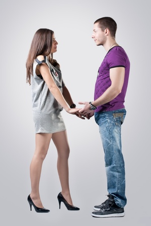 Portrait of romantic young couple over gray background. Stock Photo - 8441927