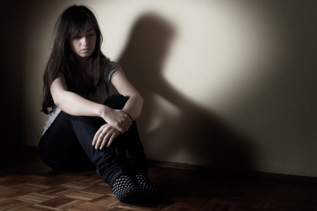 Depressed teenager girl sitting on floor. Stock Photo - 8548747