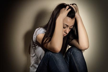 Closeup portrait of depressed teenager girl.