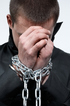 Man with a chained hands. photo