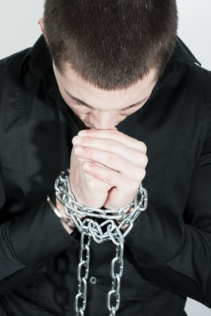 Man with a chained hands. Stock Photo - 8584776