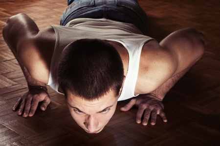 Young handsome man working push ups. Stock Photo - 8584775