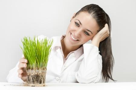 Portrait of businesswoman support green plant. photo